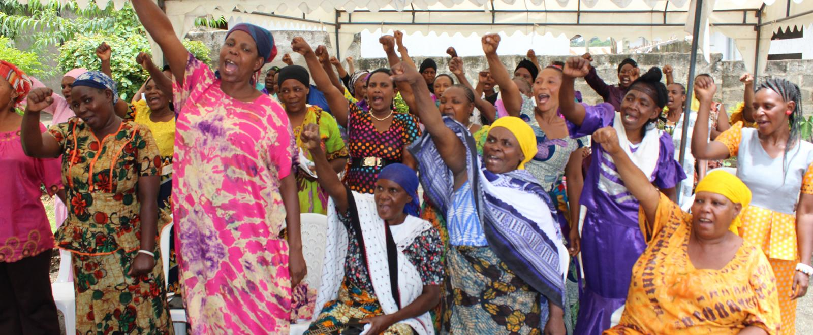 Local women attend an International Women's Day presentation at our women's empowerment program in Africa.